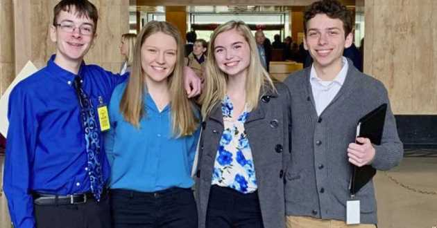 """(From left) Sam Adamson, Lori Riddle, Hailey Hardcastle, and Derek Evans pose at the Oregon State Capitol in Salem. The teens suggested legislation to allow students to take """"mental health days"""" as they would sick days."""