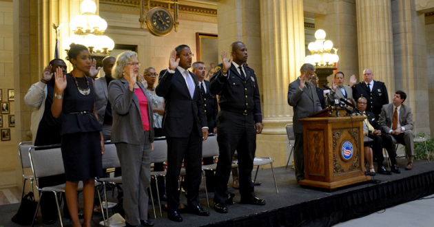 Cleveland Mayor Frank Jackson administers the oath of office to members of the Community Police Commission in 2015. [Nick Castele / ideastream]