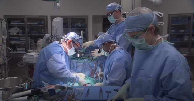 Dr. Jose Navia works to replace the damaged heart valve of an IV drug user at the Cleveland Clinic.