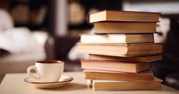 Stock photo of a stack of books and a cup and saucer.