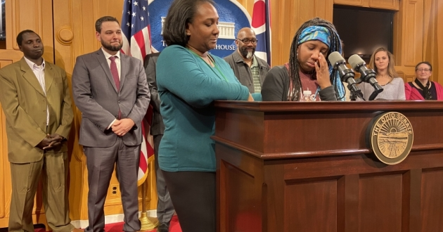 Crystal Brown, left, comforts her 15 year old daughter Josephine Brown-Walker as she talks about her EdChoice voucher, which allows her to attend a Christian high school in Columbus. [Karen Kasler]