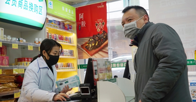 Staff sell masks at a Yifeng Pharmacy in Wuhan, China, Wednesday, Jan. 22, 2020.