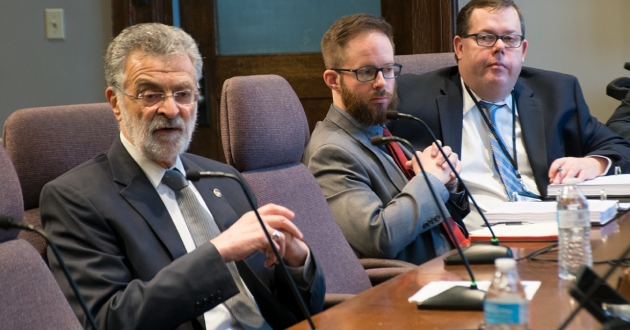 Cleveland Mayor Frank Jackson (left) addresses city council Tuesda yas council members Charles Slife and Brian Mooney look on. [Nick Castele / ideastream]