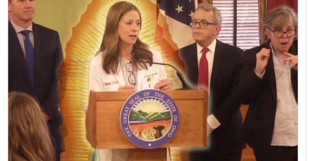 "This fan post shows Dr. Amy Acton in the middle, with (from left to right) Lieutenant Gov. Jon Husted, Gov. Mike DeWine, and sign language interpreter Marla Berkowitz, with the caption, ""Our Lady of Public Health."" [Dr. Amy Acton Fan Club Facebook page]"