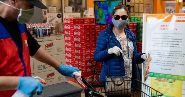 Even without symptoms, you might have the virus and be able to spread it when out in public, say researchers who now are reconsidering the use of surgical masks. [Elijah Nouvelage / Bloomberg via Getty Images]