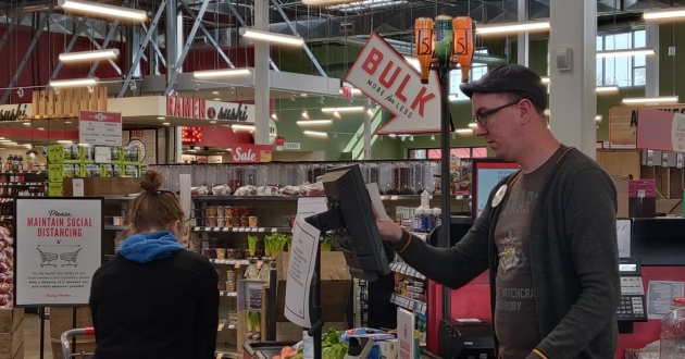 David L. Munnell says maintaining social distancing is difficult in his job as a supermarket cashier. [Lindsay Johnson]