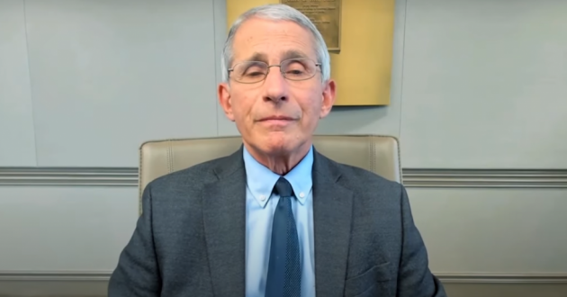 Dr. Anthony Fauci, director of the National Institute of Allergy and Infectious Diseases, delivers a graduation address during the COVID-19 pandemic.