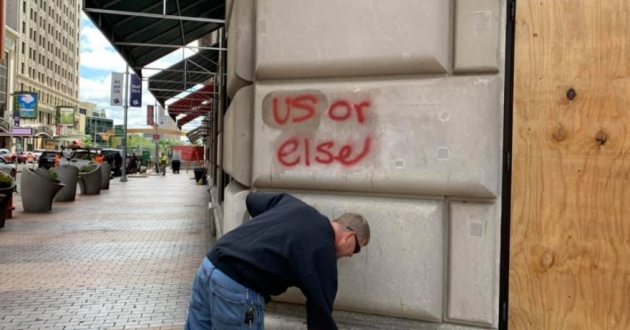 Cleaning up graffitti outside Starbucks in Cleveland's Playhouse Square