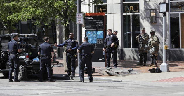Cleveland police and the National Guard patrol a corner, Monday, June 1, 2020, in downtown Cleveland.