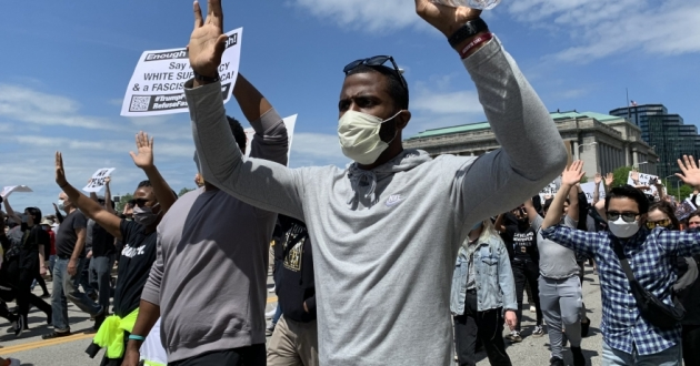 A demonstrator marching from the Cleveland Free Stamp to the Justice Center on May 30, 2020.