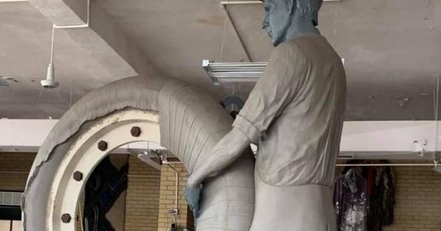 Alan Cottrill's sculpture is based on a photo of a factory worker hand-wrapping a tire [University of Akron]