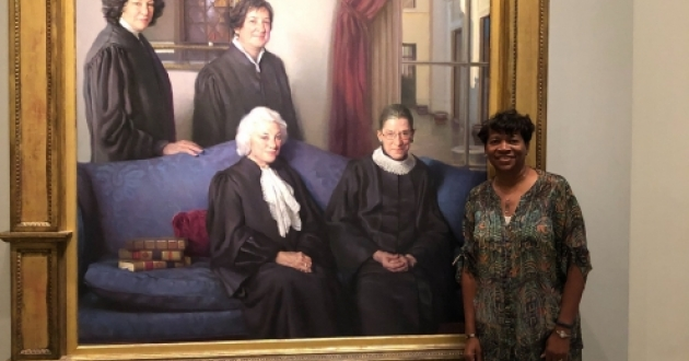 Ohio Supreme Court Justice Melody Stewart with a portrait of Supreme Court Justices Ginsburg, O'Connor, Sotomayor and Kagan [Melody Stewart]