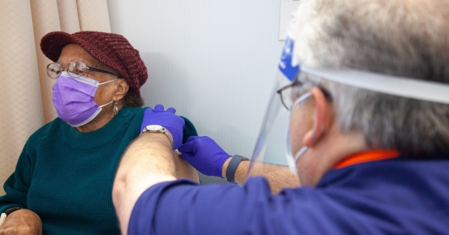 90-year-old Jether Tiller of Maple Heights received the COVID-19 vaccine at University Hospitals on Jan.19, 2020. Cleveland's Black residents make up about half of the city's population but during the virus' first peak in July, 73 percent of hospitalized patient and 60 percent of the deaths were among Black residents.