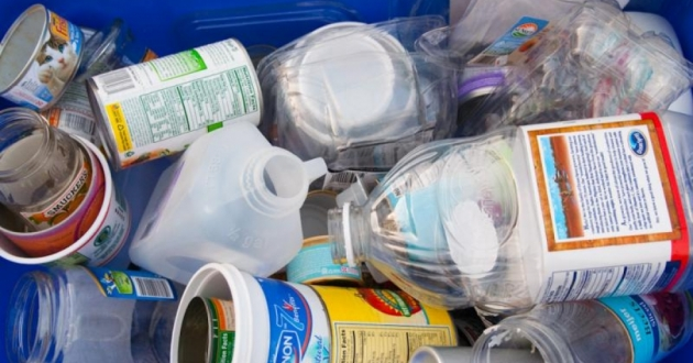 Mixed recyclables in a blue bin