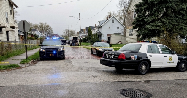 The block where a Cleveland police officer killed a suspect Thursday morning was blocked off by officers from Cleveland police and the Cuyahoga County Sheriff's Department.