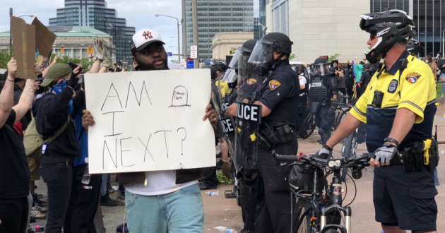 "A protester carries a sign asking ""Am I next?"" in Cleveland after the death of George Floyd. [Jenny Hamel / ideastream]"