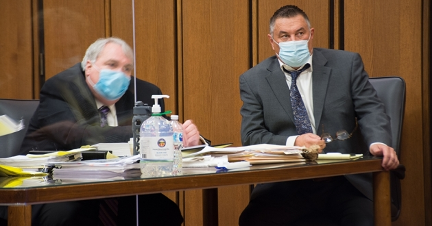 George Michael Riley, right, sits in court with one of his defense attorney, Brian Halligan. [Nick Castele / ideastream]