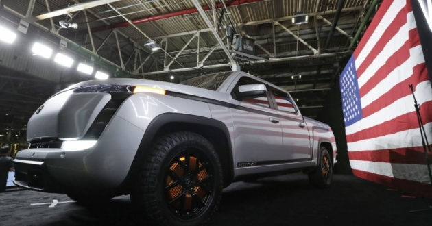 Lordstown Motors Co. Endurance electric pickup truck on stage with the American flag