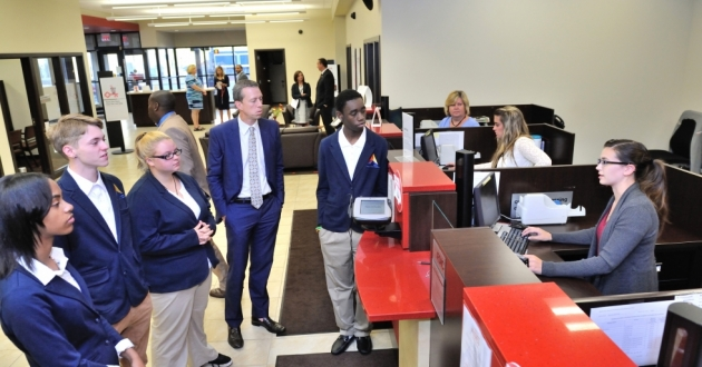 Akron's East Community Learning Center students tour a Key Bank facility with Timothy Burke, Key's president for the Northeast Ohio market. [Akron Public Schools]