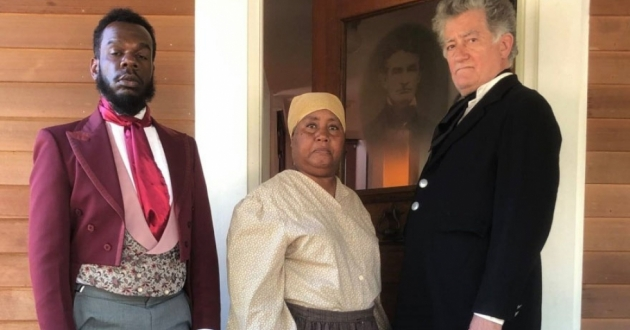 Reva Golden (center) portrays Harriet Tubman along with Corin B. Self (left) as Frederick Douglass and Dennis Runkle as John Brown standing outside an open door in play put on by Summit County Historical Society.
