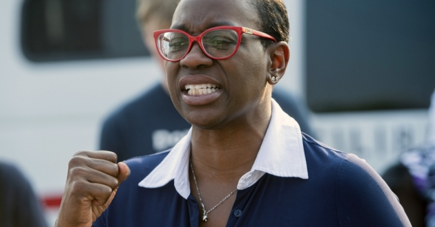 Nina Turner, a candidate running in a special Democratic primary for Ohio's 11th Congressional District, speaks with supporters near the Cuyahoga County Board of Elections in Cleveland before casting her early vote on July 7.
