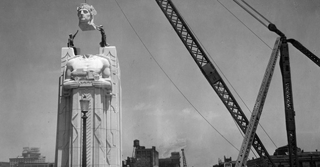 The head is lowered onto one of Cleveland's iconic Guardians of Traffic statues