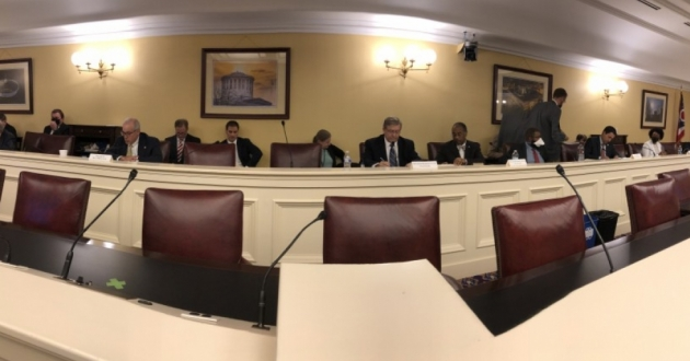 Members of the Ohio Redistricting Commission behind a long desk