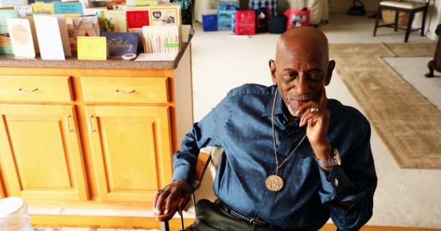 Harrison Dillard sits at his kitchen table in 2018, wearing his gold medal from 1948. He usually keeps his Olympic medals in a shoe box, but took them out at ideastream's request. [