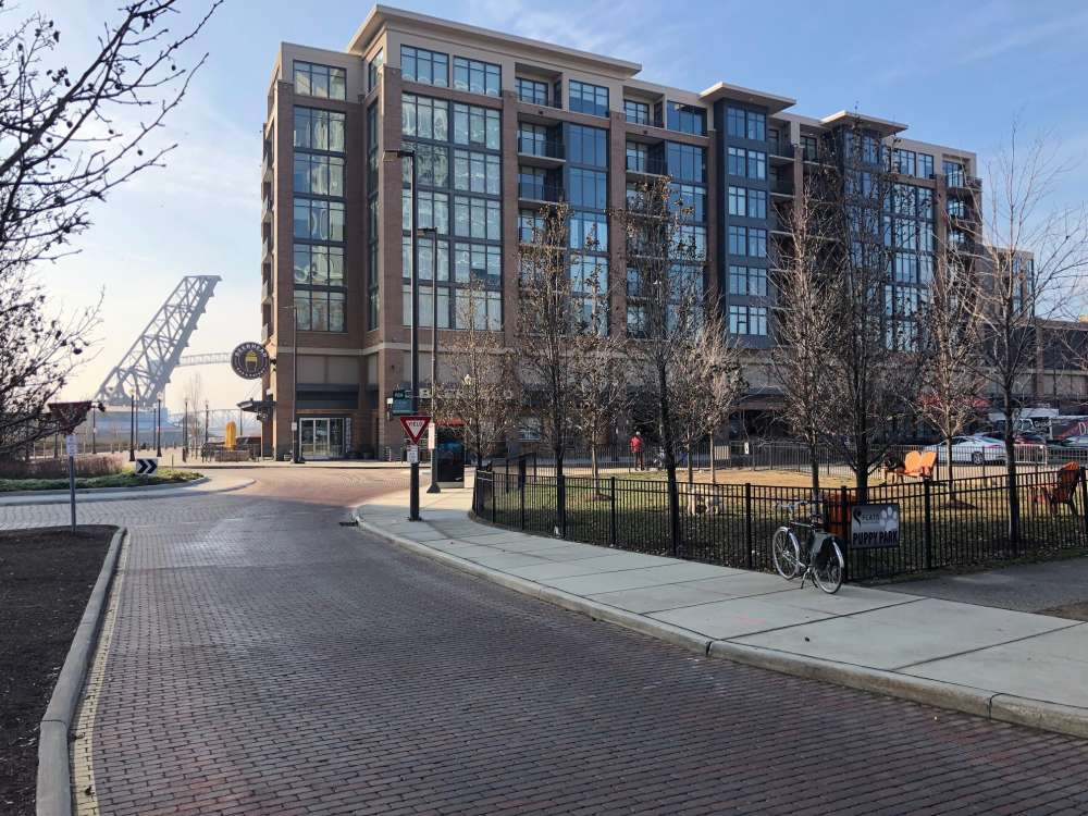 What once was a strip of bars and nightclubs has been turned into a mixed use neighborhood.  Here, the Flats East Bank apartments at the northernmost end of Old River Road. [George Hahn / ideastream]