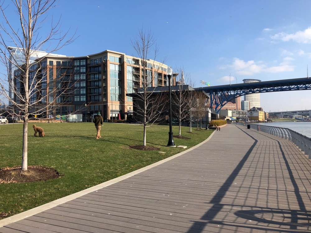 Before Flats East Bank developer Scott Wolstein added this esplanade, the only way to access the river was through the bars and restaurants lining it. [George Hahn / ideastream]