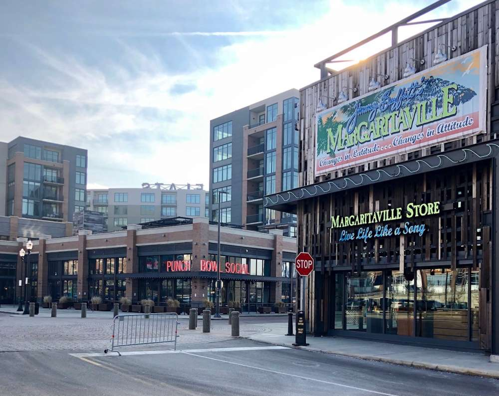 The Flats' redevelopment still has plenty of drinking and eating establishments.  Here, looking southwest on Old River Road, is Margaritaville and Punch Bowl Social.  [George Hahn / ideastream]