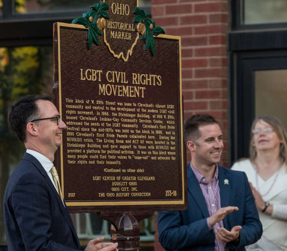 Alex Frondorf, left, and Ward 3 Cleveland City Councilman Kerry McCormack take part in the unveiling ceremony of the historical marker on W. 29th St. marking the block as the former geographic home of the city's LGBTQ community, on June 1, 2017. [Jacqueline Zema]
