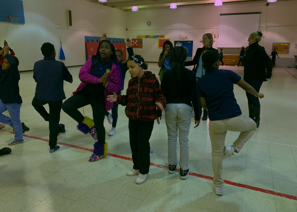 Students at Marion Sterling Elementary School in Cleveland practice yoga poses while learning about exercising and healthy habits.