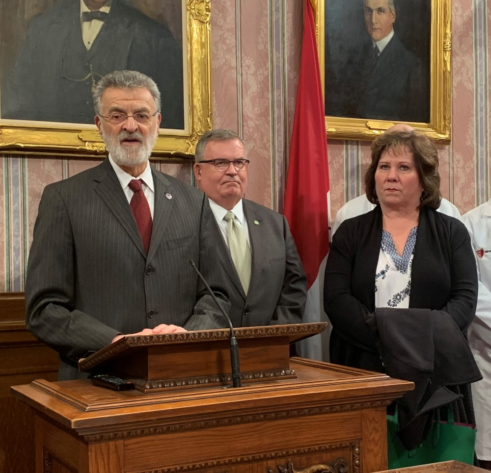 Cleveland Mayor Frank Jackson (left) announces the city is canceling its annual St. Patrick's Day parade alongside the parade committee's former executive director Patrick Murphy (center) and executive director Linda Carney.
