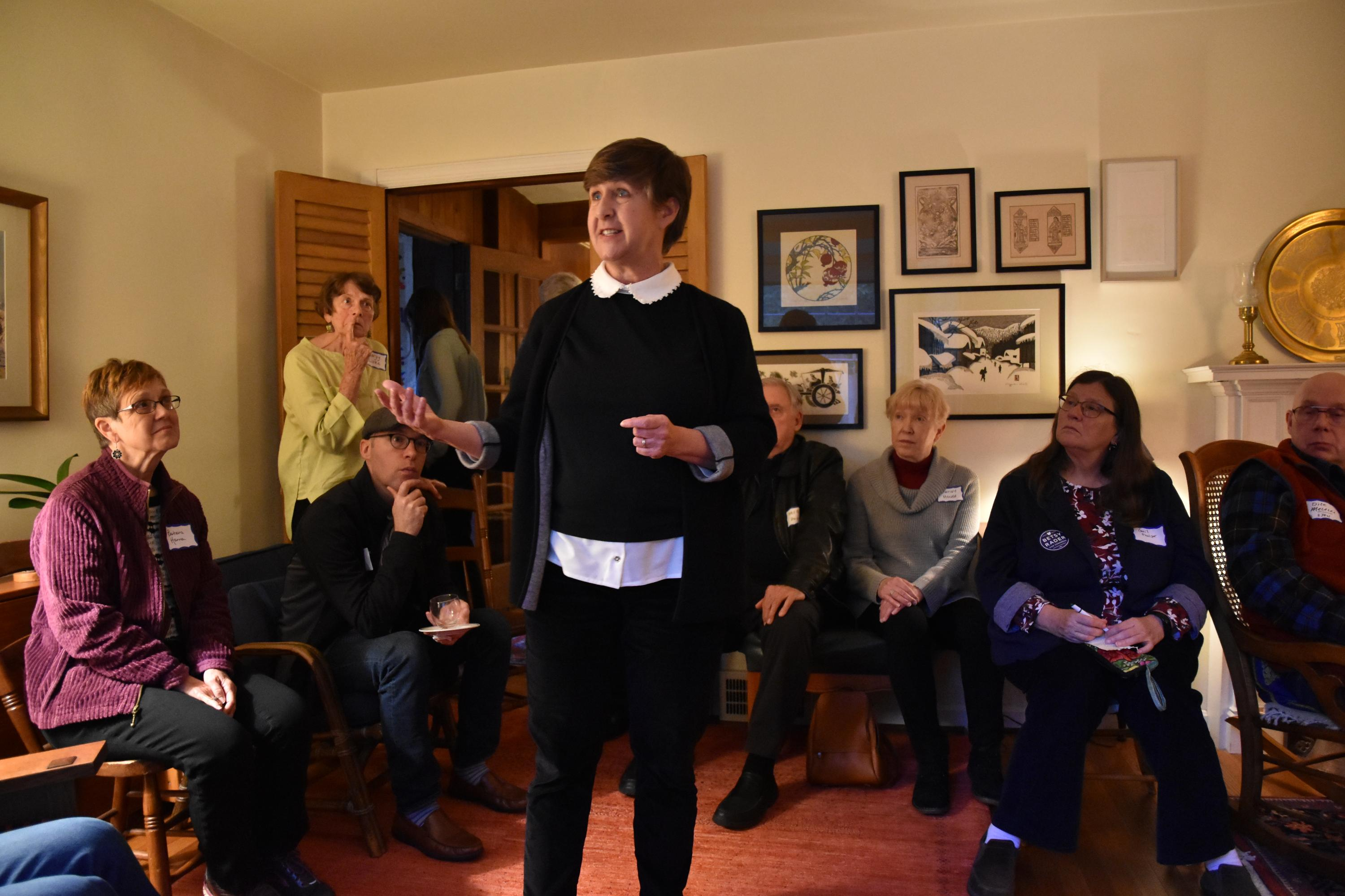 Betsy Rader talks to voters at a living room chat in Hudson