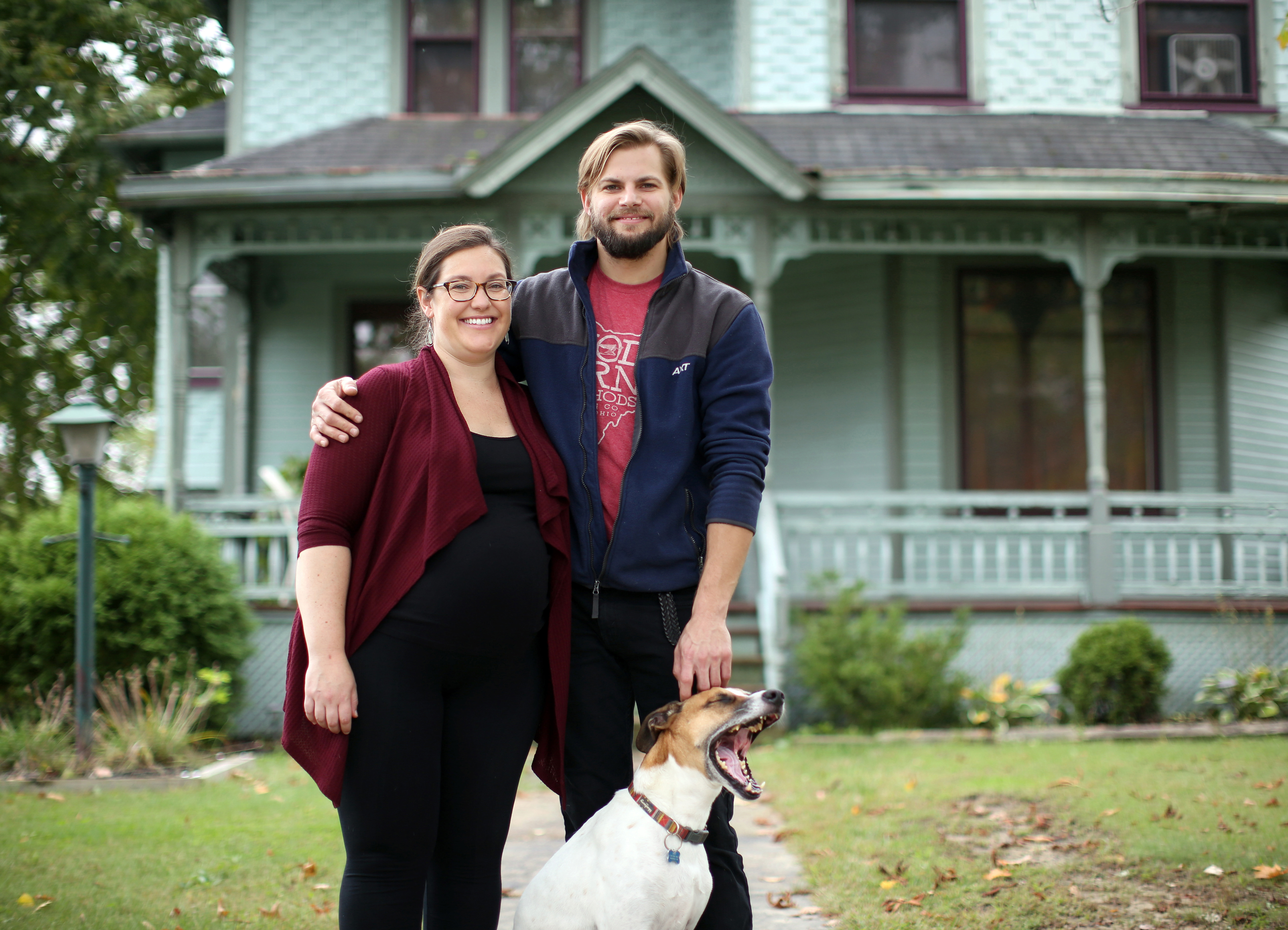 Sarah Braun and Adam Keck in front of their Victorian home in Warren, Ohio