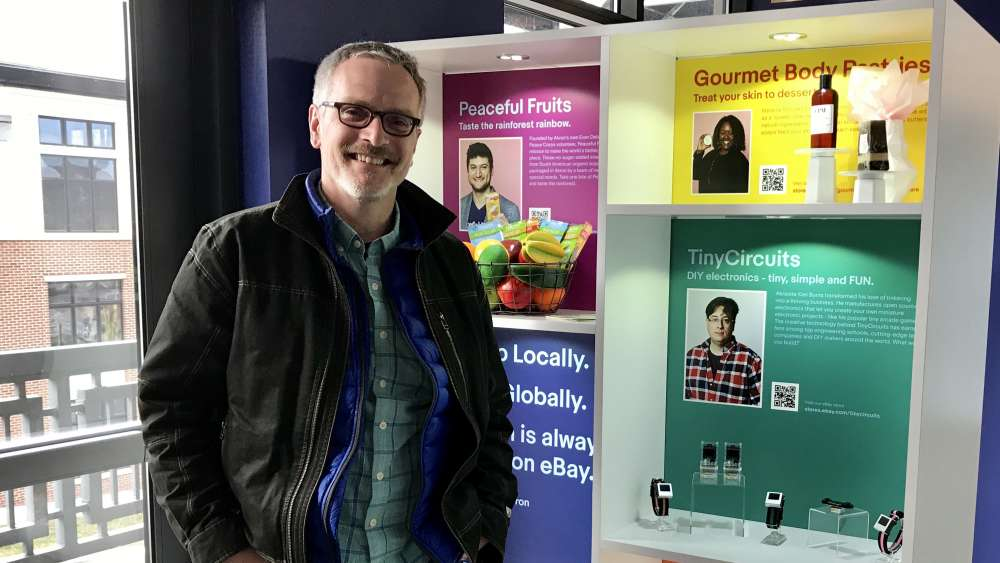 eBay's Chris Librie stands in front of a display of several local businesses participating in its Retail Revival program.