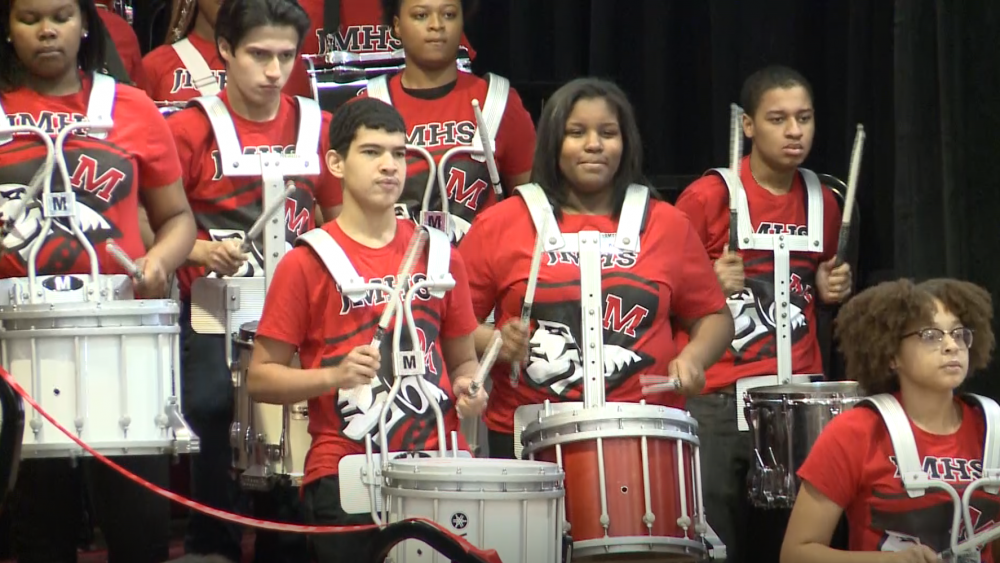 The John Marshall High School drumline performs at the Friday Say Yes Cleveland announcement [Lisa Ryan / ideastream]