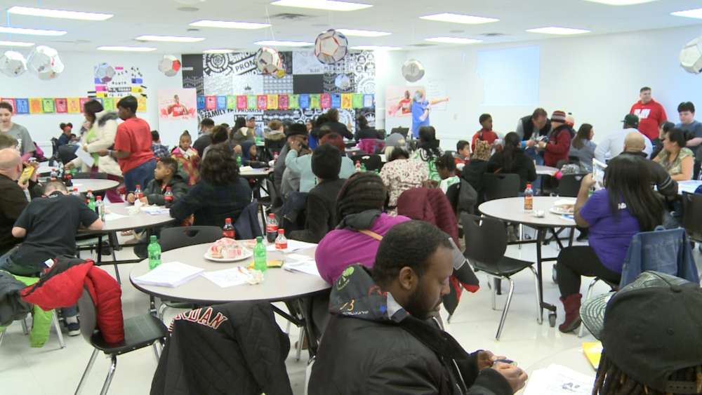 A gathering of families at Akron's I Promise school