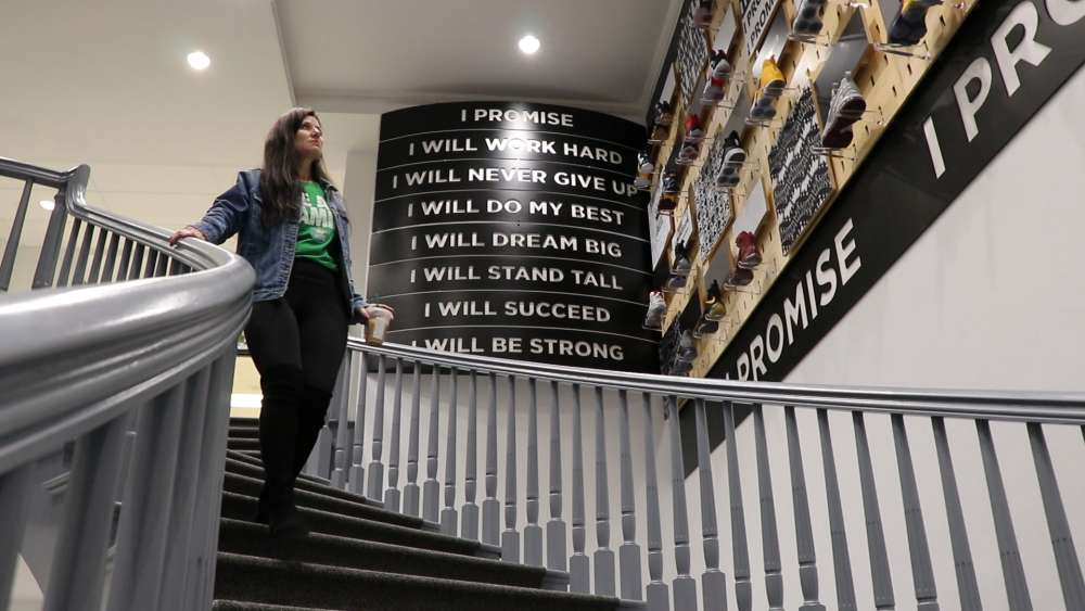LeBron James Family Foundation Executive Director Michele Campbell walks down the stairs at the I Promise school.