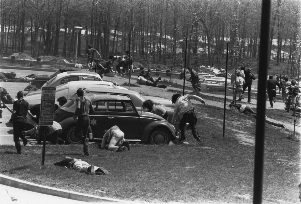 Students running in the parking lot at Kent State University