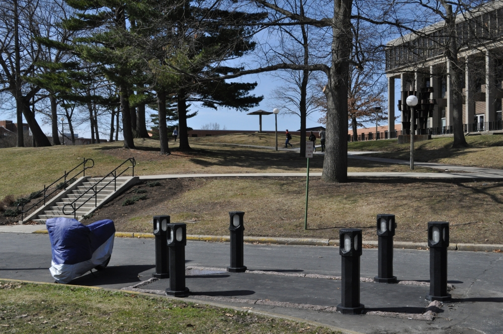 Bollards mark where Jeffrey Miller died in the Kent State parking lot.