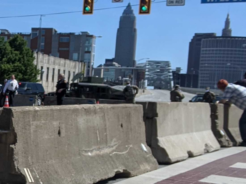 Barricades blocking cars from entering Downtown Cleveland via the Detroit-Superior bridge.