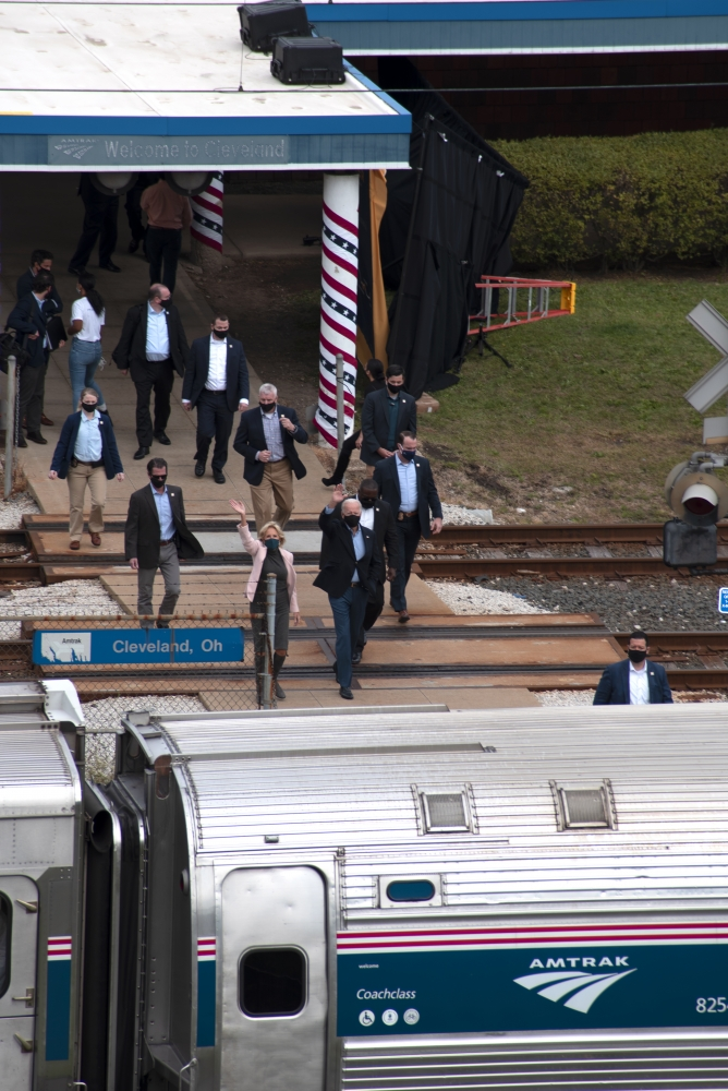 Biden and wife Jill wave to supporters standing on an overpass above the train station.