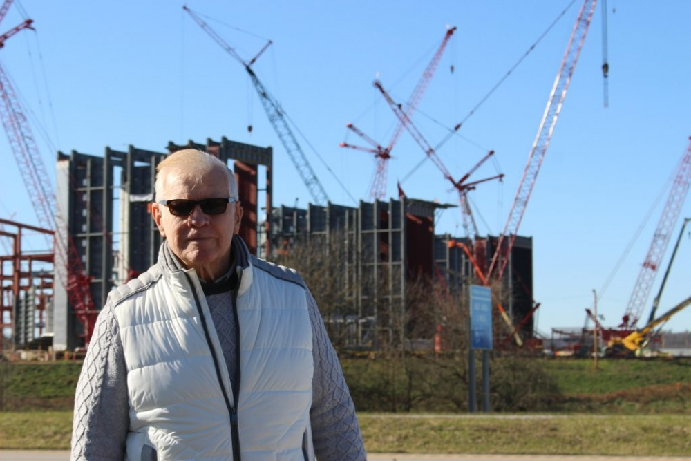 Norm Blanchard in front of the construction site for the Guernsey Power Station.