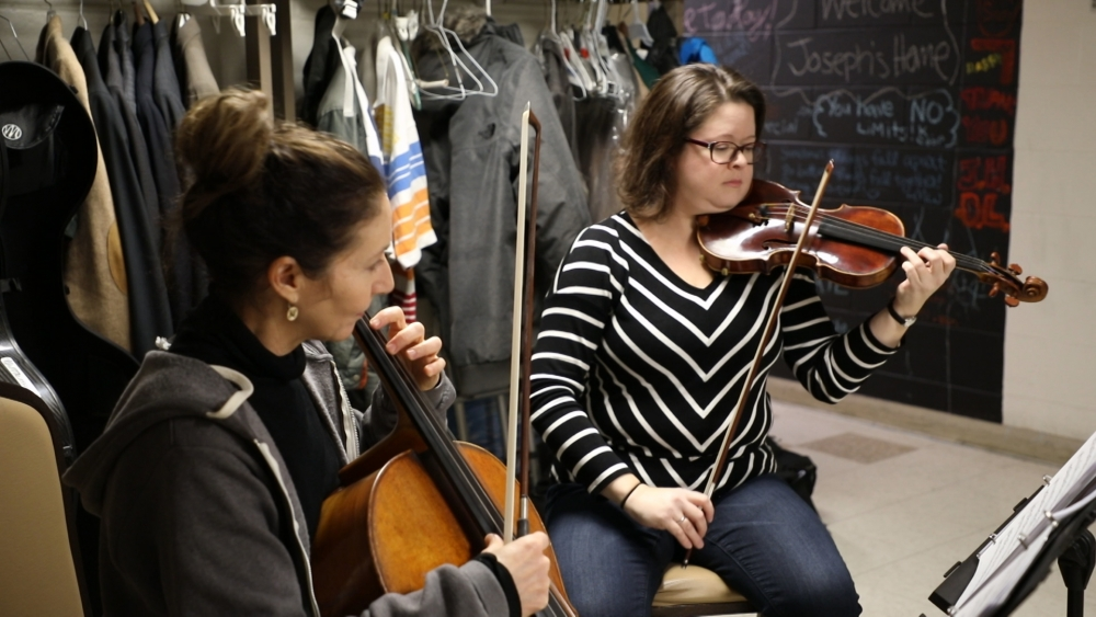 Rachel Englander plays violin for the men at Joseph's Home in Cleveland.