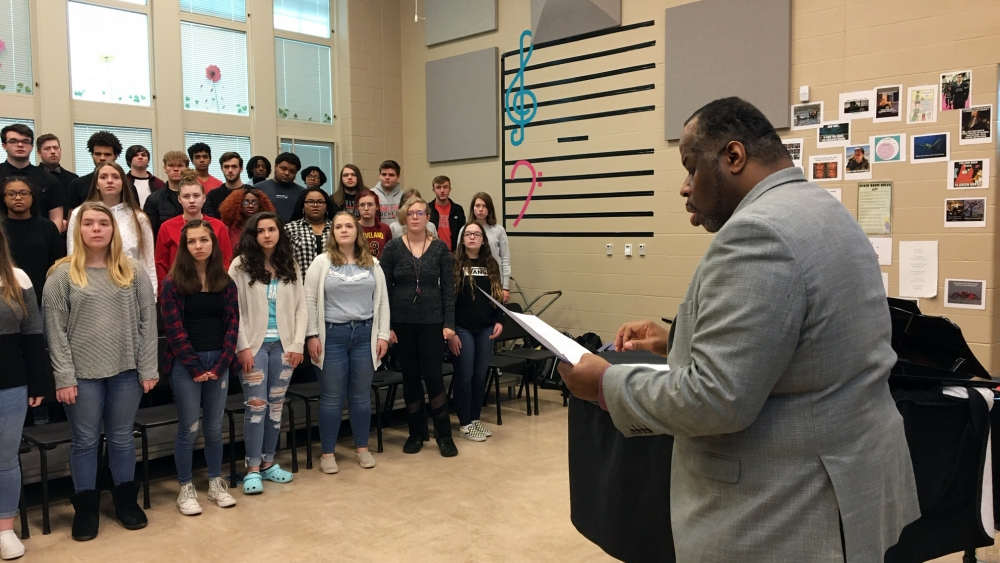 Lester Lynch works with choir students on vowel sounds during class Wednesday.