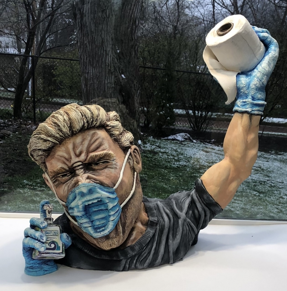 Ron White sculpture of masked man holding toilet paper and hand sanitizer