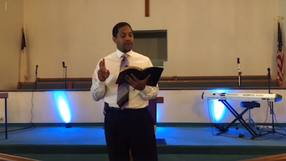 Rev. Micah Sims conducts a virtual Palm Sunday service. [Lee Memorial AME Church]