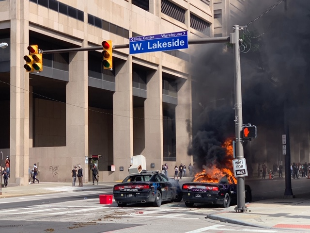 A police car was set on fire during Saturday's protest in Cleveland.